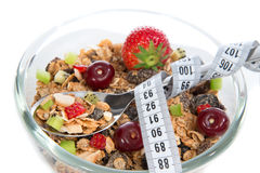 Diet weight loss concept tape measure spoon muesli cereals bowl Stock Photography