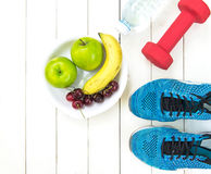 Diet and weight loss for healthy care with fitness equipment,fresh water and fruit healthy,apple green apple, banana,cherry on wh stock photos