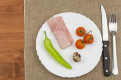 The diet for weight loss. Healthy food. Breakfast for athletes. Ham, tomatoes, pepper and quail eggs. Stock Photo