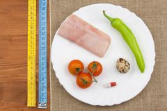 The diet for weight loss. Healthy food. Breakfast for athletes. Ham, tomatoes, pepper and quail eggs. Royalty Free Stock Photography