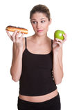 Diet Woman. Holding donut apple Royalty Free Stock Image