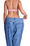 Diet Woman. Beautiful diet woman holding pants Stock Image
