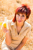Diet Woman and a banana. Woman eats a banana fruit outdoors stock photos