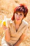 Diet Woman and a banana. Woman eats a banana fruit outdoors Stock Photos