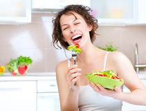 Diet. Woman Eating Vegetable Salad Royalty Free Stock Images