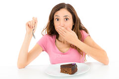 Diet woman get caught while eating cake Royalty Free Stock Photo