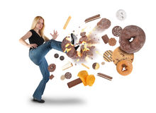 Diet Woman Kicking Donut Snacks On White Stock Photos