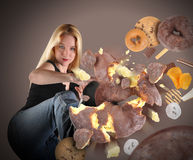 Diet Woman Kicking Junk Food Stock Image