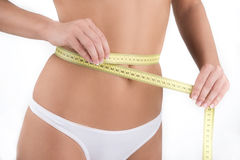 Diet. Woman measuring her waist. Isolated in white Stock Photo