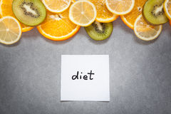 Diet - word with fruits on gray background Stock Photos
