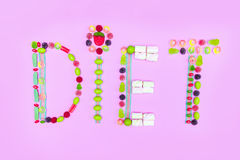 Diet word made of colorful sweets isolated on pink Royalty Free Stock Photography