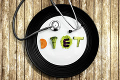 Diet word with a stethoscope above the table Royalty Free Stock Photography