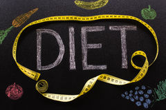 Diet word written in chalk with a yellow centimeter with vegetab Stock Photo