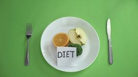 Diet written on note in plate with fruits and vegetables, healthy nutrition stock images