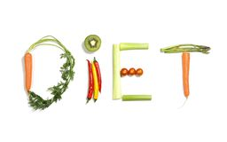 Diet written with vegetables in healthy nutrition concept. Diet written with vegetables in healthy nutrition and dieting resolution concept isolated on White royalty free stock image