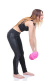 Diet. Young beautiful girl with pink dumbbells in his hands. Girl performs sporting exercise Royalty Free Stock Images
