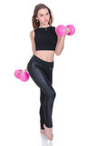 Diet. Young beautiful girl with pink dumbbells in his hands. Girl performs sporting exercise Stock Photos