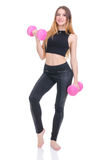 Diet. Young beautiful girl with pink dumbbells in his hands. Girl performs sporting exercise Stock Image