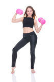 Diet. Young beautiful girl with pink dumbbells in his hands. Girl performs sporting exercise Royalty Free Stock Photo