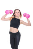 Diet. Young beautiful girl with pink dumbbells in his hands. Girl performs sporting exercise Royalty Free Stock Image