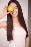 Diet. The young beautiful girl who cares for her figure, making healthy food choices, fresh fruit. The concept of healthy eating Royalty Free Stock Photo