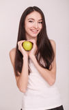 Diet. The young beautiful girl who cares for her figure, making healthy food choices, fresh fruit. The concept of healthy eating Royalty Free Stock Image