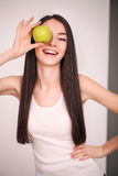 Diet. The young beautiful girl who cares for her figure, making healthy food choices, fresh fruit. The concept of healthy eating Royalty Free Stock Images