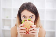 Diet. Young woman with duct tape over her mouth, preventing her. Young woman with duct tape over her mouth, preventing her to eat junk food. Healthy eating royalty free stock photography