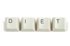 Dieta dalle chiavi di tastiera sparse su bianco Fotografia Stock