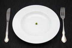 Dieta de uma ervilha Fotografia de Stock Royalty Free
