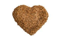Dieta de uma dieta saudável O linho cru semeia o coração do flaxseed formado em um fundo branco Imagens de Stock Royalty Free