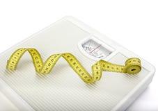 Dieta del nastro di misura del libra della scala Fotografie Stock