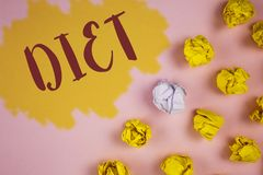 Dieta del texto de la escritura de la palabra El concepto del negocio para los dietético crea planes de la comida para adoptar y  Foto de archivo
