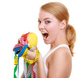 dieta Dysponowana dziewczyna z miarą taśmy i jabłczaną owoc Zdjęcie Royalty Free