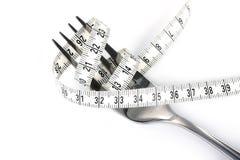 Dieta - forquilha e medida Imagens de Stock