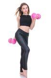 Dieta Giovane bella ragazza con le teste di legno rosa in sue mani La ragazza si esercita di sport Fotografia Stock
