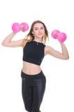 Dieta Giovane bella ragazza con le teste di legno rosa in sue mani La ragazza si esercita di sport Immagine Stock Libera da Diritti