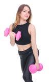 dieta Młoda piękna dziewczyna z różowymi dumbbells w jego rękach Dziewczyna wykonuje sportowego ćwiczenie Obraz Royalty Free