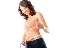 Dieta - a mulher nova está medindo sua cintura Fotos de Stock Royalty Free
