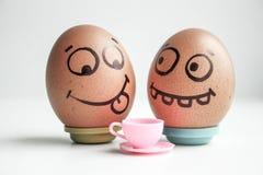 Dieta Ovos engraçados com conceito pintado da cara Fotos de Stock