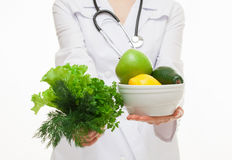 Dietarian proposing fresh greens and fruits for you Royalty Free Stock Image