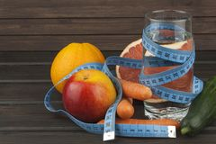 Dietary adherence to the diet program. Fresh dietary food for athletes. Fruit on a wooden table Royalty Free Stock Photos