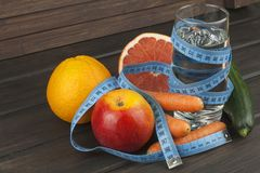 Dietary adherence to the diet program. Fresh dietary food for athletes. Fruit on a wooden table Stock Photos