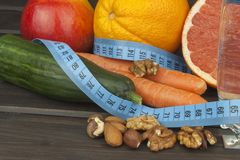 Dietary adherence to the diet program. Fresh dietary food for athletes. Fruit on a wooden table Stock Images