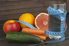 Dietary adherence to the diet program. Fresh dietary food for athletes. Fruit on a wooden table Royalty Free Stock Image