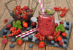 Dietary berry smoothies. On a brown background royalty free stock images