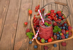 Dietary berry smoothies. On a brown background stock image