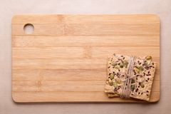 Dietary bread. Diet and health. Dietary bread and cutting board. Diet and health concept stock images