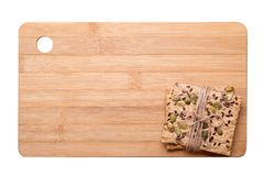 Dietary bread. Diet and health. Dietary bread and cutting board. Diet and health concept royalty free stock image