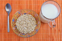 Dietary breakfast: oatmeal and milk. On the table Royalty Free Stock Photography